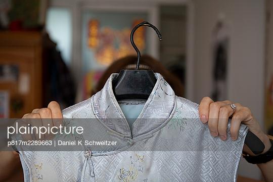 Sleeveless dress on clothes hanger - p817m2289663 by Daniel K Schweitzer