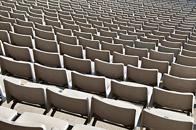 Rows of empty seats in sport stadium - p301m714606f by Etienne Girardet