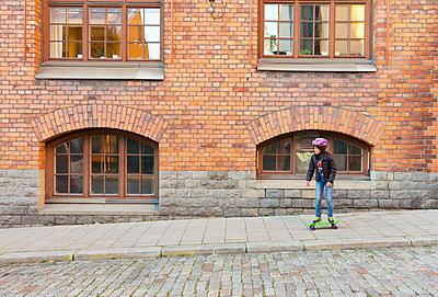 Girl skateboarding - p312m1114083f by Susanne Kronholm