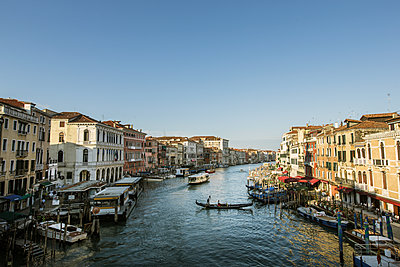 Italy, Venice, Canal in city with gondolas and boats - p352m1127275f by Mickael Tannus