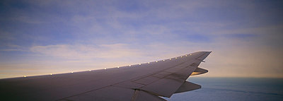 View of aeroplane wing over clouds - p6090146 by WRIGHT