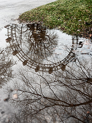Viennese Ferris Wheel reflected in a puddle - p1383m2100711 by Wolfgang Steiner