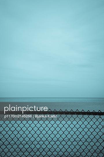 Lake beyond fence - p1170m2145266 by Bjanka Kadic