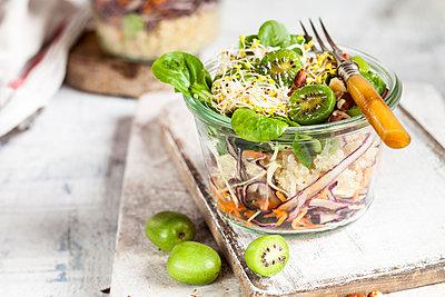 Quinoa salad with lamb's lettuce, cabbage, mini kiwi and hazelnuts - p300m2103622 by Susan Brooks-Dammann