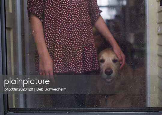 Girl with Dog in Doorway - p1503m2020420 by Deb Schwedhelm