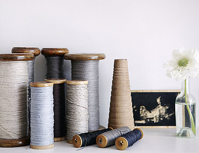 Assorted threads on vintage bobbins in London home - p349m790429 by Brent Darby