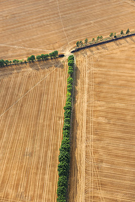 Three stubble fields aerial view - p1048m1069290 by Mark Wagner