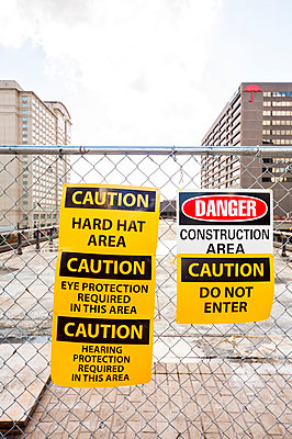 'Caution' and 'Danger' signs - p397m813235 by Peter Glass