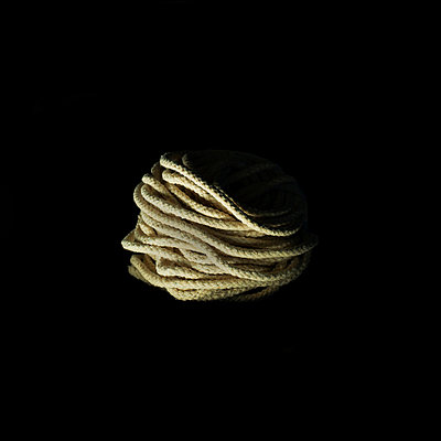 Rope on black background - p1072m954953f by Katerina Makasi