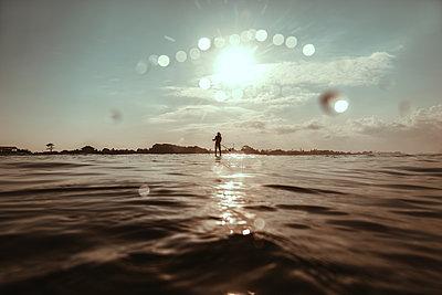 Sup surfer - p1166m2137198 by Cavan Images