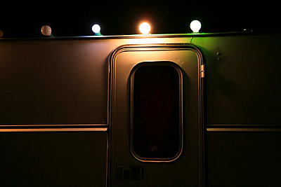 Fairy lights on a caravan - p927m1132561 by Florence Delahaye