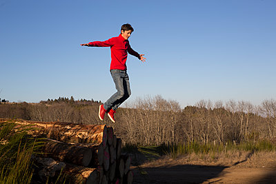 Teenager jumping - p445m1199989 by Marie Docher