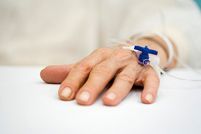 Patient's hand with IV drip - p62314466f by Ale Ventura