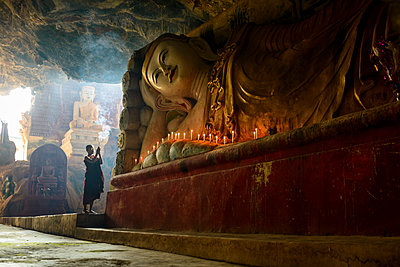 Asian monk lighting incense in temple,Hpa-An, Kayin, Myanmar - p1100m2084225 by Mint Images