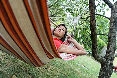 Woman in hammock - p427m2007532 by R. Mohr