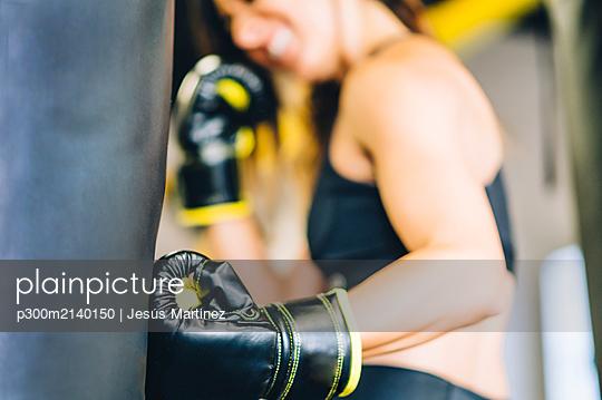 Female boxer training in gym - p300m2140150 by Jesús Martinez