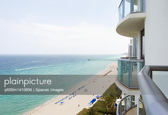 Hotel balcony overlooking urban beach