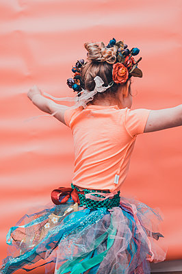 LIttle girl spinning with a tutu on - p1628m2233799 by Lorraine Fitch