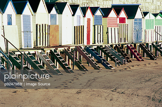 Beach huts - p9247983f by Image Source