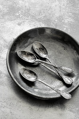 Pewter plate with silver spoons - p450m1131666 by Hanka Steidle