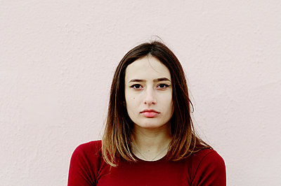 Portrait of a girl in a red sweater - p1412m2054333 by Svetlana Shemeleva