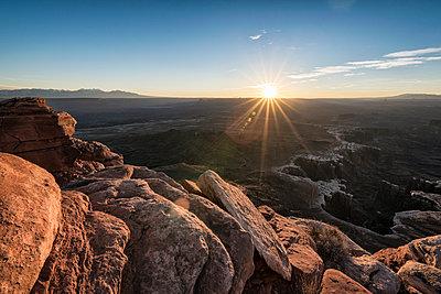 Sunset in canyon, Moab, Utah, United States - p555m1522878 by Patrick Lienin