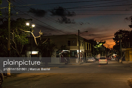 Sunset on the street - p1291m1531861 by Marcus Bastel