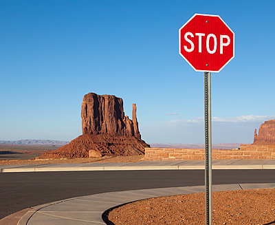 Stop Sign and Mesa in the Desert - p1100m2090877 by Mint Images