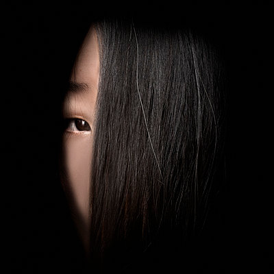 Portrait of Woman's Face Partially Covered with Long Hair - p694m2145295 by Maciej Toporowicz photography