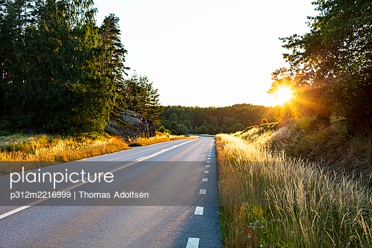 Country road at sunset - p312m2216999 by Thomas Adolfsén