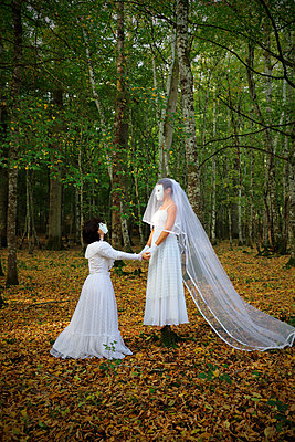 Brides with white masks in the forest - p1521m2214987 by Charlotte Zobel