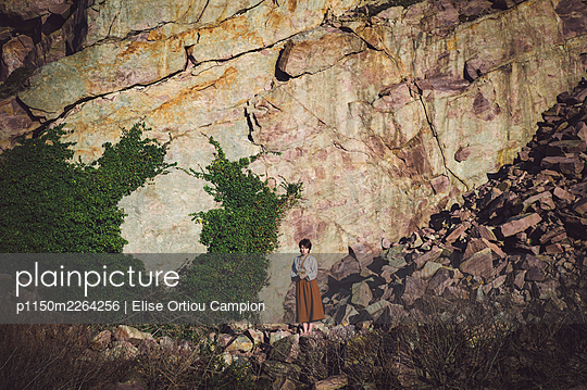France, Girl at the bottom of a cliff - p1150m2264256 by Elise Ortiou Campion