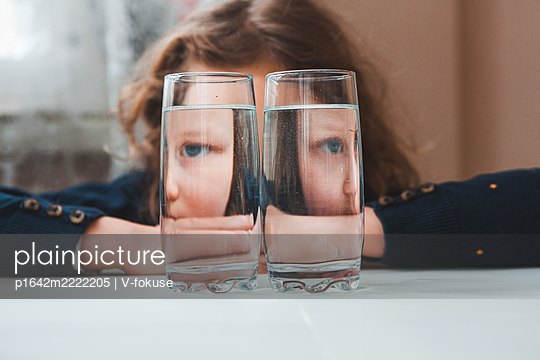 Reflection of girl in two glasses with water - p1642m2222205 by V-fokuse