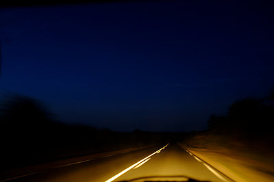 Speeding drive view of a road in the night - p1096m2063668 by Rajkumar Singh