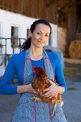 Farmwoman with hen - p42911080f by Judith Haeusler
