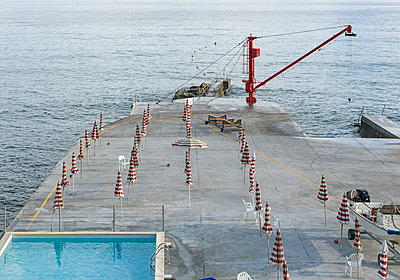 Coastal pier with crane for motorboats - p1292m1171794 by Niels Schubert