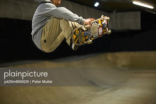 Young man doing skateboard trick