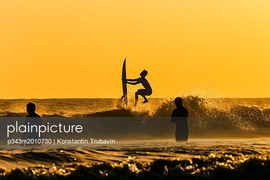 Surfer at sunset - p343m2010730 by Konstantin Trubavin