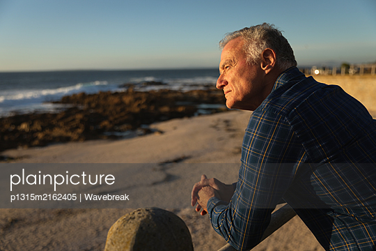 Man enjoying time by the sea - p1315m2162405 by Wavebreak