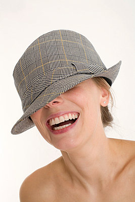 Woman with a man's hat - p7750004 by angela pfeiffer