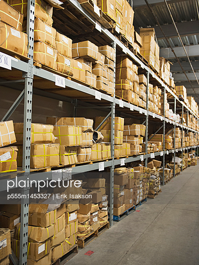 Shelves of boxes in textile factory