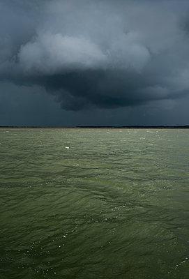 dark clouds over Terschelling - p1132m1486812 by Mischa Keijser