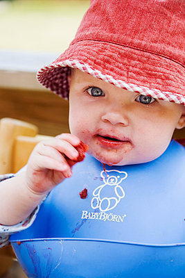 A baby eating strawberries Sweden. - p31217173f by Camilla Sjödin