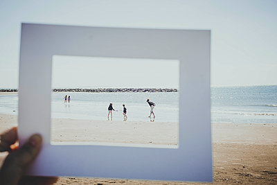 Family on beach - p445m1528741 by Marie Docher