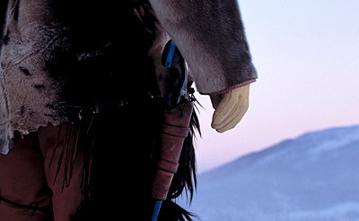 Sweden, Lapland - Mid section view of a person in traditional Sami Clothes - p3483594 by Nicklas Blom