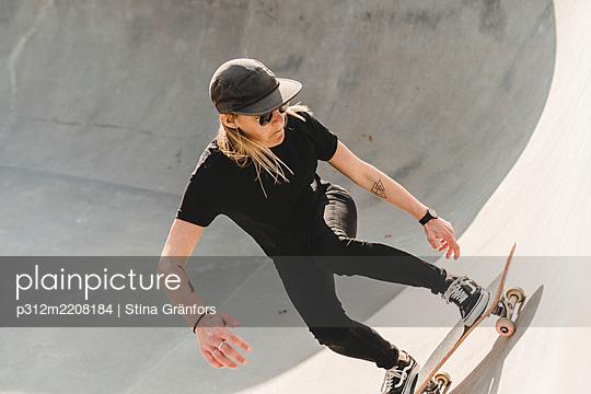 Woman in skate park - p312m2208184 by Stina Gränfors
