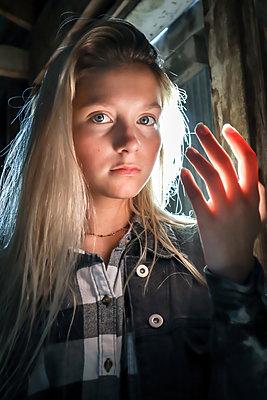 Teenage girl looking at camera - p1019m2127923 by Stephen Carroll