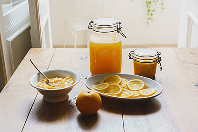 High angle view of citrus fruit sauces and preserves on table - p301m1180532 by Halfdark