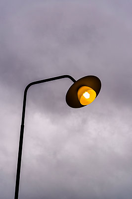 Street lamp against overcast sky - p1170m1491683 by Bjanka Kadic