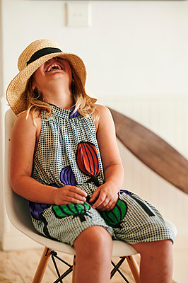 Little girl with straw hat is having fun - p1640m2242152 by Holly & John